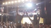 зависать : Crowd of devoted fans jumping and dancing at rock concert, super slow motion