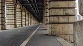 radical : Cycling lanes running between arches of Pont de Bercy in Paris, time-lapse