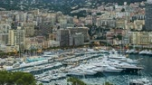 facing : Monaco day to night timelapse, view on buildings and moored yachts in marina