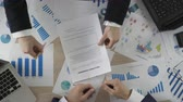 hr : Man signing employment agreement, HR manager hiring new employee, top view Stock Footage