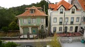 csempézett : Beautiful houses in quiet residential district with tiled red roofs, sequence