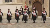 alay : Performance in Zagreb, Cravat Regiment standing in a line near St. Marks church Stok Video