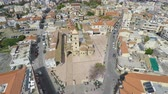 chipre : Drone floating high in air and filming aerial view of beautiful European city Vídeos