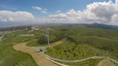 gerar : Large wind turbines standing in the fields, eco-friendly electricity generation