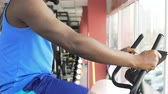 stationary : Athletic male riding a stationary bike in the fitness club, sport and health