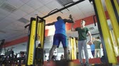 supporting : Friends training in gym together, giving high five after active workout, fitness