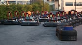 eğlence peşinde : Two male friends enjoying ride at kart circuit, having fun together, competition Stok Video