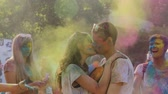 passionately : Couple in love passionately kissing at Color festival in cloud of bright powder