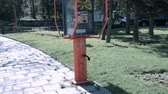 средство : Payphone receiver hanging up in air and falling down, no one around, mystery