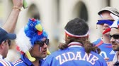 maskot : Fans at football match, French supporters wearing funny headwear discussing game