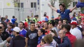 french : Happy French fan sitting on friends shoulders and shouting, outdoor fan-zone