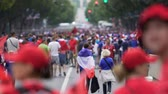 social event : Excited football fans walking in the street with flags, outdoor fan-zone Stock Footage