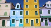 shabby : View on old colorful residential houses in Burano, sunny day in Venice Stock Footage