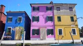опрятный : Colorful buildings on Burano island, view on blue, purple and yellow houses