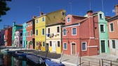 water curtain : Panoramic view of beautiful multicolored houses and canal in Burano, Venice