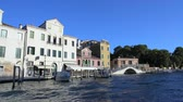 parked : Water taxi sailing on canal, tour in Venice, view on white bridge and houses Stock Footage