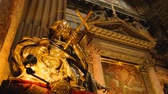 aziz : Beautiful golden statues of saints standing in Naples cathedral, religion