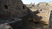 kulturní : Remains of constructions and houses in Pompeii Naples Italy with preserved jugs