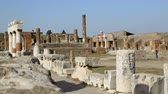 destruído : Temple of Jupiter in Pompeii, Italy with remains of buildings and columns around