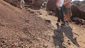 formed : Many tourists walking along dangerous slope of volcanic origin mountains Stock Footage