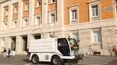 süpürge : Cleaning truck driving down embankment road, service and ecology, cityscape Stok Video