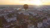 bizakodó : Blue-and-yellow air balloon flying over town at dawn towards sun, fantasies
