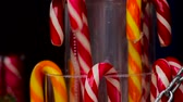 streetfood : Tasty colorful candies in form of magic staff sold at festive open air fair