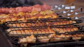 streetfood : Large amount of unhealthy fatty junk food cooking on grills at street festival