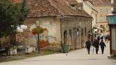 ザグレブ : Tourists walking in beautiful old street with red roof buildings, Zagreb city