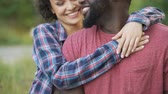 checker : Black man and mixed race woman tenderly hugging, happy people smiling together