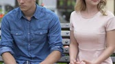 slap : Angry blond girl giving a slap to her unfaithful boyfriend and walking away Stock Footage