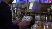 cash register : Restaurant worker typing on cash register, accepting an order from customer Stock Footage