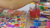 произведение искусства : Small kid blends all possible colors on a piece of paper, imaginative mind