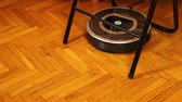 присоска : Autonomous robovac stuck while cleaning the floor, modern vacuuming process