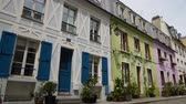 paryż : Nice street with colorful houses and cozy hotel in France, hospitality business