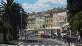 neighbor : People walking quiet street with terraced buildings, sunny day in Nice, France