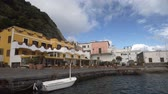 neapol : Resort in Ischia town, white boat floating on water near quay, summer travel