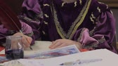 quill : Young male writing billet-doux letter with quill, costume party of Medieval Ages Stock Footage