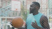 dunking : Basketball coach eagerly waiting for team at sports ground, outdoor training