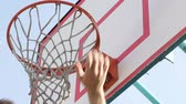 dunk : Bottom view of sportsman scoring, ball in basket, streetball competition