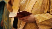 pope : Priest beginning divine liturgy, crossing himself and praying god for blessing
