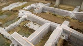 сохранение : Archeological excavations covered with plastic sheets, ruins protection, history
