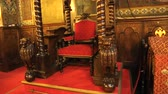 symbol of respect : Red chair with armrests standing on church cathedra, bishops throne, decorations