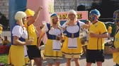 szwecja : Happy supporters of Sweden football team posing dressed in funny costumes