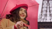çapkın : Young woman with umbrella flirting, looking for acquaintance, smiling to man Stok Video