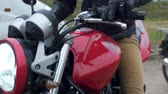 long distance : Red motorbike with turned on headlight, motocross in rain, race in countryside
