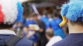 fiel : Supporters in funny hats with mascots gathering to support national soccer team Vídeos