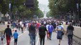 primórdios : Crowd of fans walking along main street of Marseille, waiting match beginning Vídeos