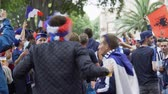fiel : Football fans posing and dancing at camera in funny masks on faces, having fun