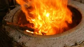 tandoor : Hot fire burning in deep circular clay oven, tone warming up in Georgian bakery